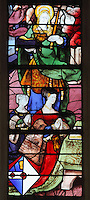 St Genevieve, 422-502 AD, and ladies kneeling and praying in Renaissance costume, stained glass window by Romain Buron of Gisors, 1530, restored c. 1950, in the Collegiate Church of Saint-Gervais-Saint-Protais, built 12th to 16th centuries in Gothic and Renaissance styles, in Gisors, Eure, Haute-Normandie, France. The church was consecrated in 1119 by Calixtus II but the nave was rebuilt from 1160 after a fire. The church was listed as a historic monument in 1840. Picture by Manuel Cohen