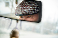 The mirror's reflection of a taxi driver in Kyrgyzstan