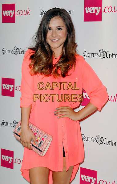 Electra Formosa  <br /> attends the Very.co. uk SS14 Fashion Range launch Party at Claridges Hotel in London, England, UK,<br /> September 12th 2013.<br /> half length shirt  dress hand on hip clutch bag peach pink <br /> CAP/PP<br /> &copy;PP/Capital Pictures