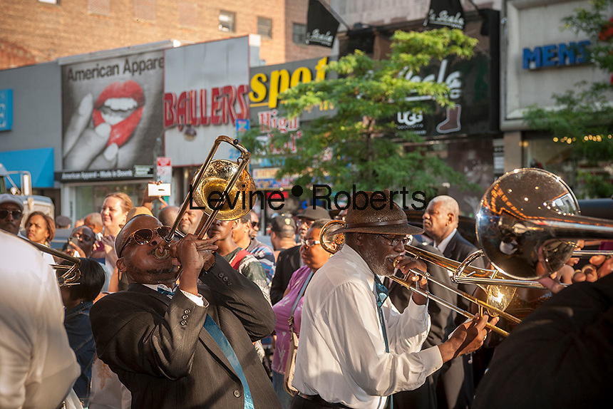 """McCollough Sons of Thunder gospel band performs in front of the Apollo Theater in Harlem in New York on Friday, June 21, 2013 prior to a showing of Christine Turner's documentary film """"Homegoings""""s featuring Isaiah Owens, the owner of Owens Funeral Home  The film features Owens and his funeral home as it studies African-American traditions of death. Owens, who moved to New York in the 1960's, opened the funeral home and with just word of mouth and little advertising has become the paramount funeral home in Harlem, due to his care and understanding.  (© Richard B. Levine)"""
