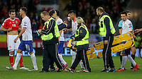 Dusan Tadic of Serbia (C) receives first aid by team physiotherapists after being injured on the face during the 2018 FIFA World Cup Qualifier between Wales and Serbia at the Cardiff City Stadium, Wales, UK. Saturday 12 November 2016