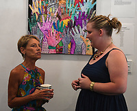 NWA Democrat-Gazette/J.T. WAMPLER Gwynne Gertz of Fayetteville (LEFT) visits with Sophia Dugwyler Thursday Aug. 2, 2018 during a reception for the artists of Life Styles latest exhibition, ÒConspire to InspireÓ at Stage 18 in Fayetteville. Life Style artists worked in groups towards the goal of uniting their personal styles to create something greater together. Life Styles Inc. supports individuals with disabilities in reaching their full potential as contributing members of the community. Dugwyler is one of four art teachers at Life Styles.