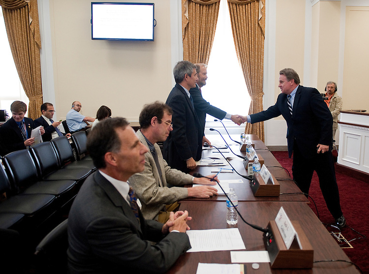 "UNITED STATES - JUNE 20: Rep. Christopher Smith, R-N.J., right, shakes hand with witnesses before chairing the The Commission on Security and Cooperation in Europe (Helsinki Commission) hearing on ""2050: Implications of Demographic Trends in the Organization for Security and Co-operation in Europe,"" in the Rayburn House Office Building on Monday, June 20, 2011. (Photo By Bill Clark/Roll Call)"