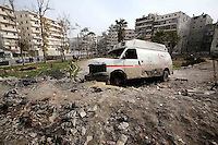 Photographer: Rick Findler/Borderline News..18.01.13 An ambulance, destroyed by airstrikes from President Assad's regime forces, sits off the road in the heart of Aleppo, Northern Syria.