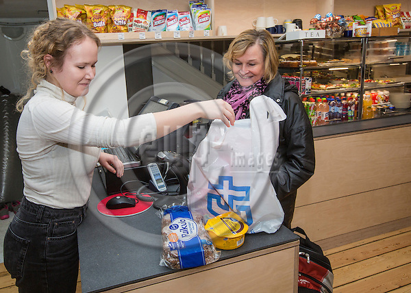 BRUSSELS - BELGIUM - 04 February 2016 --Laura Hellbon voluntary worker with customer Tuula Hautala-Niemi at the Finnish Seamen's Church. -- PHOTO: Juha ROININEN / EUP-IMAGES