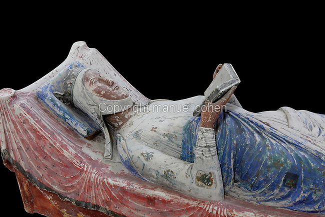 Royal tomb of Eleanor of Aquitaine in the nave of the Abbey Church at Fontevraud Abbey, Anjou, France. Eleanor of Aquitaine, 1122-1204, Queen consort of King Henry II of England, is reading a book, a symbol of her unusual stature and learning. The Plantagenet rulers were benefactors of the monastery. The effigy is carved in stone and was painted, she wears a crown and nun's wimple and her robes are blue and white. Fontevraud Abbey was founded in 1100 by Robert of Arbrissel and became a double monastery for both monks and nuns, led by an Abbess. The Order was dissolved during the French Revolution. Picture by Manuel Cohen