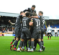 Lincoln City players jump on Michael Bostwick to celebrate the fourth goal<br /> <br /> Photographer Andrew Vaughan/CameraSport<br /> <br /> The EFL Sky Bet League Two - Port Vale v Lincoln City - Saturday 13th October 2018 - Vale Park - Burslem<br /> <br /> World Copyright © 2018 CameraSport. All rights reserved. 43 Linden Ave. Countesthorpe. Leicester. England. LE8 5PG - Tel: +44 (0) 116 277 4147 - admin@camerasport.com - www.camerasport.com