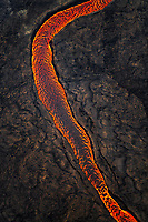 aerial view of lava channel, flowing towards the ocean, from lava eruption along fissure vents, Leilani Estates, Kilauea, Big Island, Hawaii, USA