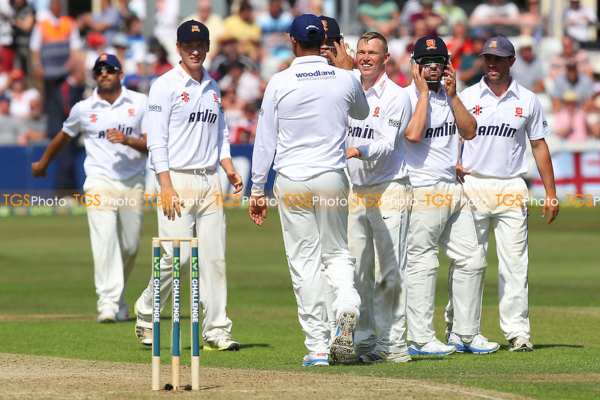 Tom Craddock of Essex celebrates the wicket of Kevin Pietersen with his team mates - Essex CCC vs England - LV Challenge Match at the Essex County Ground, Chelmsford - 30/06/13 - MANDATORY CREDIT: Gavin Ellis/TGSPHOTO - Self billing applies where appropriate - 0845 094 6026 - contact@tgsphoto.co.uk - NO UNPAID USE