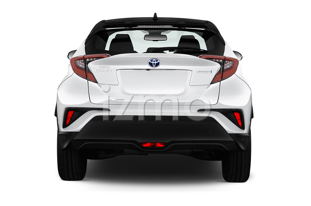 Straight rear view of a 2018 Toyota C-HR C-LUB hybrid 5 Door SUV stock images