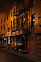 Chinese businesses on Doyers St at night, in Chinatown, Manhattan, New York, New York, USA. This is the largest enclave of Chinese people in the Western Hemisphere and one of 9 Chinatown districts in New York City. Picture by Manuel Cohen