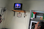 A man watches a TV broadcasting Israeli Defense Minister Ehud Barak, in the Palestinian refugee camp of Al-Amarai, near Ramallah, West Bank.