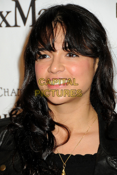 MICHELLE RODRIGUEZ .3rd Annual Women In Film Pre-Oscar Party held at a Private Residence in Beverly Hills, California, USA, .4th March 2010..portrait headshot black leather smiling gold necklace .CAP/ADM/BP.©Byron Purvis/AdMedia/Capital Pictures.