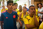 Colombian football fans watch their national team's Russia 2018 World Cup Group H match against Japan in a bar. Irun (Basque Country). June 19, 2018. (Gari Garaialde / BostokPhoto)