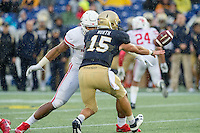 Annapolis, MD - OCT 8, 2016: Navy Midshipmen quarterback Will Worth (15)pitches the ball just before being hit by Houston Cougars defensive end Cameron Malveaux (94) during game between Houston and Navy at Navy-Marine Corps Memorial Stadium Annapolis, MD. The Midshipmen upset #6 Houston 46-40. (Photo by Phil Peters/Media Images International)