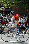 A rainbow painted biker cruises past parade watchers in the 21st annual Summer Solstice Parade held Saturday, June 20, 2009 in Seattle, Wa. The parade was held Saturday, bringing out painted and naked bicyclists, bands, belly dancers and floats. (Jim Bryant Photo © 2009). .
