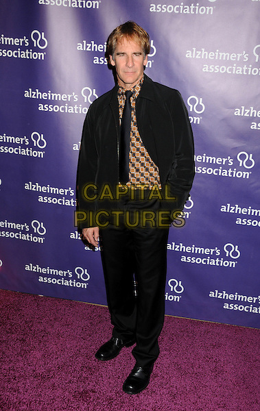 "SCOTT BAKULA .19th Annual ""A Night at Sardi's"" Benefiting the Alzheimer's Association held at the Beverly Hilton Hotel, Beverly Hills, California, USA, 16th March 2011..full length suit black tie brown print shirt hand in pocket .CAP/ADM/BP.©Byron Purvis/AdMedia/Capital Pictures."