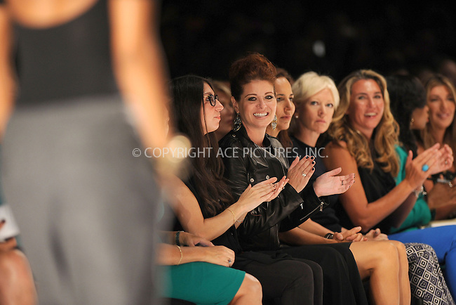 WWW.ACEPIXS.COM . . . . . .September 7, 2012...New York City.....Debra Messing watches the runway at the Project Runway Spring 2013 fashion show during Mercedes-Benz Fashion Week on September 7, 2012 ...Please byline: KRISTIN CALLAHAN - ACEPIXS.COM.. . . . . . ..Ace Pictures, Inc: ..tel: (212) 243 8787 or (646) 769 0430..e-mail: info@acepixs.com..web: http://www.acepixs.com .