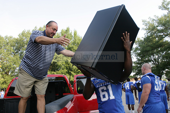 UK football players helped students and parents move in to South Campus dorms on Friday, Aug. 19, 2011, in Lexington, Ky. Photo by Becca Clemons | STAFF