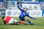 Suwon Midfielder Kim Jongwoo (R) reacts after trips up with Guangzhou Forward Gao Lin (L) during the AFC Champions League 2017 Group G match Between Suwon Samsung Bluewings (KOR) vs Guangzhou Evergrande FC (CHN) at the Suwon World Cup Stadium on 01 March 2017 in Suwon, South Korea. Photo by Victor Fraile / Power Sport Images