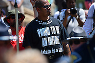 "Cleveland, OH - July 19, 2016: A member of the Westboro Baptist Church displays a shirt that reads, ""Proud to be an infidel, Islam is a Lie"" at a protest in the Public Square during the Republican National Convention in downtown Cleveland, Ohio, July 19, 2016.  (Photo by Don Baxter/Media Images International)"