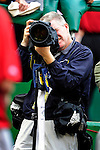 15 August 2010: Photographer Tim Cammett takes an image during an Arizona Diamondbacks game against the Washington Nationals at Nationals Park in Washington, DC. The Nationals defeated the Diamondbacks 5-3 to take the rubber match of their 3-game series. Mandatory Credit: Ed Wolfstein Photo