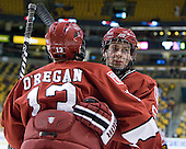 Tommy O'Regan (Harvard - 13), Dan Ford (Harvard - 5) - The Harvard University Crimson defeated the Northeastern University Huskies 3-2 in the 2012 Beanpot consolation game on Monday, February 13, 2012, at TD Garden in Boston, Massachusetts.