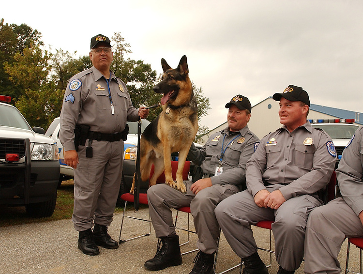 From left, Sgt. T.J. Williams, his k-9 Baron, Tech. Michael Mulcahy, Tech. Tim Cullen and Tech. James Webb attend the opening ceremony of the new U.S. Capitol Police K-9 facility which is located at the U.S. Botanical Gardens Nursery facility in SW.