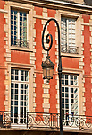 Red brick houses built in 1612 by Henri IV that ring the Place des Vosges, the oldest planned square in Paris, France