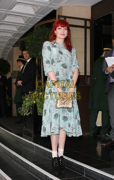 FLORENCE  WELCH of Florence And The Machine .Attending the English National Ballet Summer Party, The Dorchester hotel, Park Lane, London, England, UK,.15th June 2010.arrivals full length blue green grey gray patterned pattern print dress gold clutch bag black socks ankle boots lace-up sleeves bracelet rings .CAP/ROS.©Steve Ross/Capital Pictures.