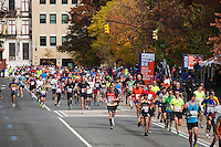 Runners pass through Harlem in New York near the 22 mile mark near Mount Morris Park on Sunday, November 3, 2013 in the  annual ING New York City Marathon. The marathon was cancelled in 2012 because of Superstorm Sandy and this year security was extra tight in the wake of the recent bombing at the Boston Marathon.  (© Richard B. Levine)