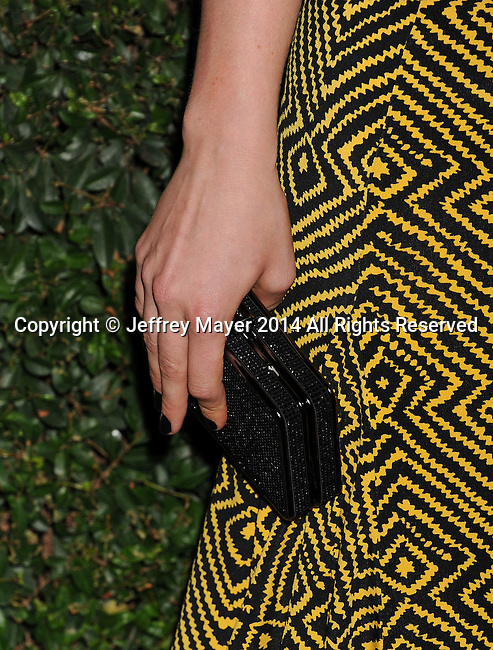 BEVERLY HILLS, CA- OCTOBER 02: Actress Leven Rambin (handbag detail) at the Michael Kors Hosts Launch Of Claiborne Swanson Frank's 'Young Hollywood' Portrait Book at a private residence on October 2, 2014 in Beverly Hills, California.