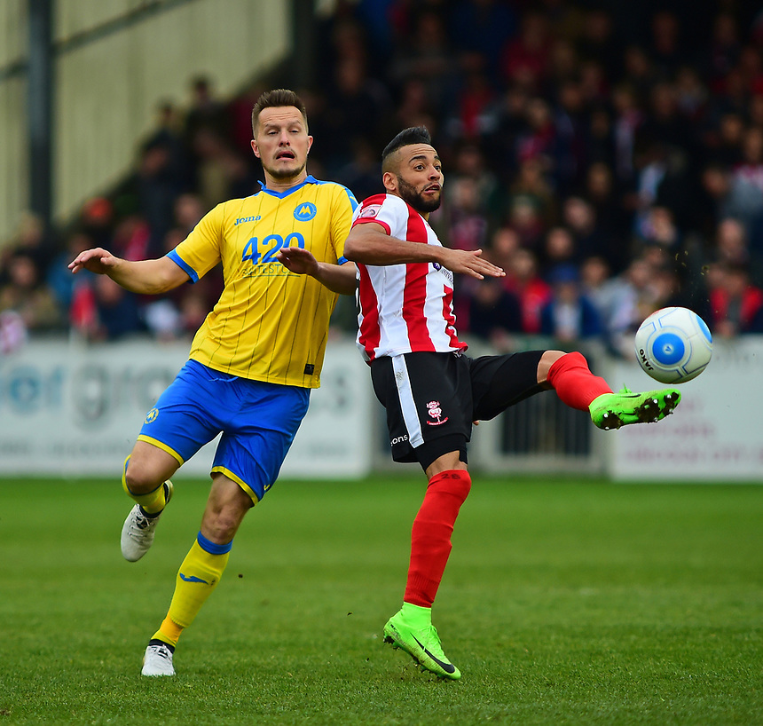 Lincoln City's Nathan Arnold vies for possession with Torquay United's Shaun Harrad<br /> <br /> Photographer Andrew Vaughan/CameraSport<br /> <br /> Vanarama National League - Lincoln City v Chester - Tuesday 11th April 2017 - Sincil Bank - Lincoln<br /> <br /> World Copyright &copy; 2017 CameraSport. All rights reserved. 43 Linden Ave. Countesthorpe. Leicester. England. LE8 5PG - Tel: +44 (0) 116 277 4147 - admin@camerasport.com - www.camerasport.com