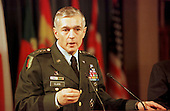 United States Army General Wesley Clark, Supreme Allied Commander Europe (SACEUR) speaks at a Joint Press Conference with North Atlantic Treaty Organization (NATO) Secretary General, Doctor Javier Solana at NATO headquarters in Brussels, Belgium on March 25, 1999..Credit: NATO via CNP...