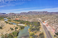 Distant aerial view of mountains and Rio Grande as the River Rd runs along side.
