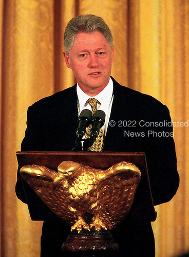 United States President Bill Clinton speaks at the annual prayer breakfast in the White House's East Room September 11, 1998 in Washington, DC. Reading from notes as his hushed audience of more than 100 ministers, priests and other religious leaders listened, the president said he had a broken spirit but still hoped to redeem the nation's trust.     .Credit: Richard Ellis / Pool via CNP