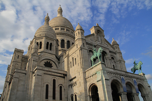 France, Paris.  <br /> Thankful for the nice clouds and warm lighting. This was all that was left after eliminating the swarming masses. Afternoon at Sacre-Coeur Basilica in Paris, France.