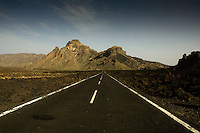 Empty road In Las Cañadas national park. Lava fields both sides of the road. Tenerife, Canary Islands,Spain.