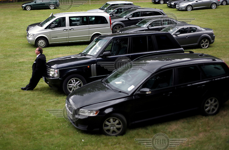 A man waits in a car park during the Royal Ascot race meeting. The annual event, during which each day begins with the Queen's arrival in a horse drawn carriage, dates back to 1711 when Queen Anne organised the first races on what was then a heath near Windsor Castle.