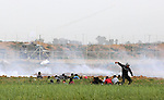 Palestinian protesters gather during clashes with Israeli troops in tents protest where Palestinians demand the right to return to their homeland at the Israel-Gaza border, in Khan Younis in the southern Gaza Strip, on February 15, 2019. At least 20 protesters were injured by Israeli security forces during clashes along the Gaza border, the health ministry in Hamas-run enclave said. Photo by Ashraf Amra