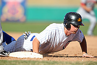 Mesa Solar Sox infielder D.J. LeMahieu #7 dives back to first during an Arizona Fall League game against the Phoenix Desert Dogs at HoHoKam Park on November 3, 2011 in Mesa, Arizona.  Mesa defeated Phoenix 8-7.  (Mike Janes/Four Seam Images)