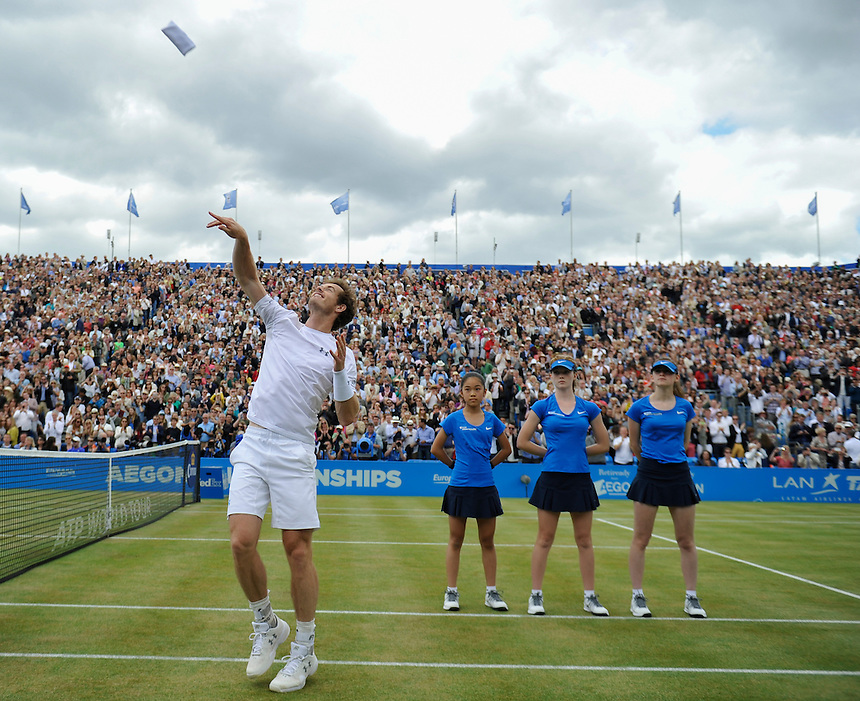 Andy Murray (GBR) throws his wrist bands to the crowd after his victory over Kevin Anderson (RSA) in their Men&rsquo;s Singles Final match - Andy Murray (GBR) def Kevin Anderson (RSA) 6-3, 6-4<br /> <br /> Photographer Ashley Western/CameraSport<br /> <br /> Tennis - ATP 500 World Tour - AEGON Championships- Day 7 - Sunday 21st June 2015 - Queen's Club - London <br /> <br /> &copy; CameraSport - 43 Linden Ave. Countesthorpe. Leicester. England. LE8 5PG - Tel: +44 (0) 116 277 4147 - admin@camerasport.com - www.camerasport.com
