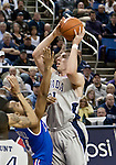 March 3, 2012:   Nevada Wolf Pack forward Olek Czya shoots over Louisiana Tech Bulldogs Kenyon McNeail during their NCAA basketball game played at Lawlor Events Center on Saturday night in Reno, Nevada.