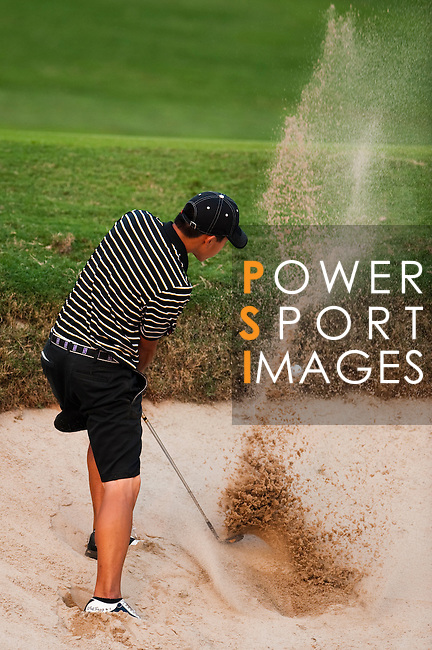 SHENZHEN, CHINA - OCTOBER 29:  Eric Chun of South Korea hits out of a bunker during the day one of Asian Amateur Championship at the Mission Hills Golf Club on October 29, 2009 in Shenzhen, Guangdong, China.  (Photo by Victor Fraile/The Power of Sport Images) *** Local Caption *** Eric Chun
