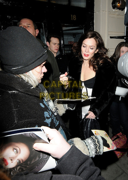"ANNA FRIEL .leaves after her final evening performance of ""Breakfast At Tiffany's"", Theatre Royal, Haymarket, London, England, UK, 9th January 2010 .half length black fur coat signing autographs fans pen .CAP/CAN.©Can Nguyen/Capital Pictures"
