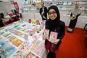 An exhibitor shows Ana Muslim books at the Malaysia booth during the Tokyo International Book Fair in Tokyo Big Sight on September 25, 2016. The 23rd edition of Tokyo International Book Fair (TIBF) attracted 470 exhibitors and approximately 40,000 visitors over the three days from September 23 to 25. (Photo by Rodrigo Reyes Marin/AFLO)