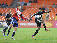 D.C. United midfielder Clyde Simms (19) controls the ball against Chivas USA forward Alejandro Moreno (15). Chivas USA tied D.C. United 2-2 at RFK Stadium, Wednesday  September 20 , 2011.