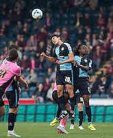 Luke O'Nien of Wycombe Wanderers wins the ball in the air during the Sky Bet League 2 match between Wycombe Wanderers and Northampton Town at Adams Park, High Wycombe, England on 3 October 2015. Photo by Andy Rowland.