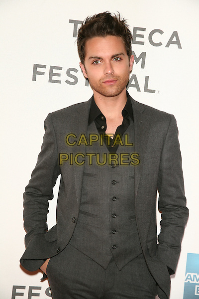 "THOMAS DEKKER .attends the 10th Anniversary Edition of the Tribeca Film Festival - World Premiere of ""Angels Crest"" at the Tribeca Performing Arts Center, New York, NY, USA, April 22nd, 2011..half hands in pockets  length grey gray suit waistcoat black shirt  .CAP/LNC/TOM.©LNC/Capital Pictures."