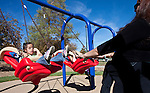 Connie Morales pushes 7-year-old Ximena Rios on the swings during the grand opening of Inspiration Station, located at Dick Taylor Park in Reno.  The Junior League of Reno and the City of Reno celebrated the opening of the regions only universally accessible playground on Saturday afternoon, October 20, 2012.